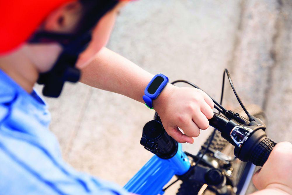 Fitbit_Ace_3_Lifestyle_Cosmic_Blue_Sidewalk_Boy_with_Bike_061
